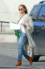 Isla Fisher At Keeps warm in a cozy wool sweater while running errands in West Hollywood