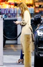 Isla fisher Pulls over to fill up her tank after running errands in LA