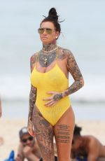 Jemma Lucy In yellow On the beach in Sydney