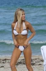 Joy Corrigan Doing a photo shoot on the beach in Miami
