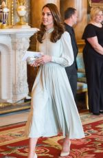 Kate Middleton Attends a reception to mark the 50th anniversary of the investiture of the Prince of Wales at Buckingham Palace in London