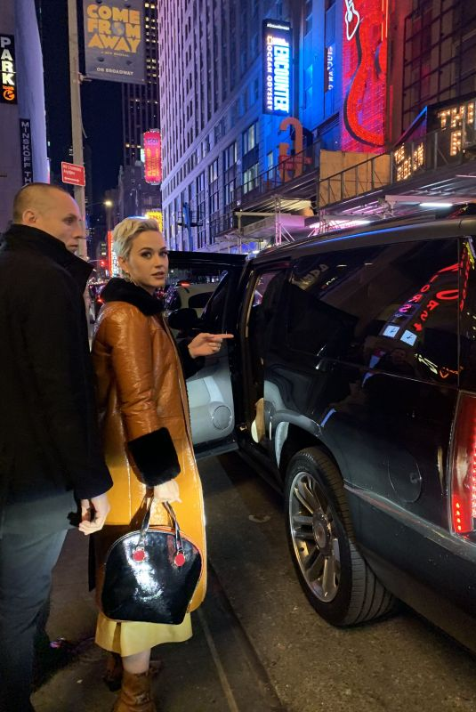 Katy Perry Poses for a selfie with a fan as she leaves the Shubert Theatre in NYC