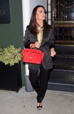 Kyle Richards Puts on a brave face for a private event at