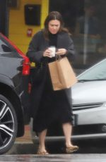 Mandy Moore Braves another winter rainstorm to pick up a cup of coffee and a bag of pastries in LA