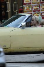 """Margot Robbie Rides in style in a yellow Jaguar on the set of """"Birds Of Prey"""" filming in Los Angeles"""
