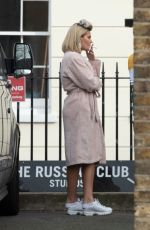 Megan Barton Hanson pictured in hair rollers as she takes a smoke break from a shoot in East London