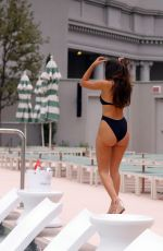 Tao Wickrath Enjoys the sun at the pool during the St.Patrick
