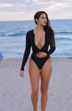 Tao Wickrath In Black Swimsuit on the Beach in Miami