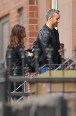 Anne Hathaway and Adam Shulman take a cab with their son on a family outing in NYC