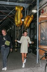 Bella Hadid Heads out holding GIGI balloons while celebrating her sister Gigi