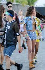 Chantel Jeffries and Ross Butler exploring the fair grounds with friends at Coachella in Indio