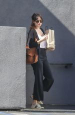 Dakota Johnson Leaves book soup with a LARGE bags of books In West Hollywood