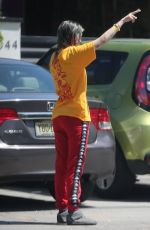 Dani Thorne Goes to the curb to pick up food that she had delivered in Los Angeles