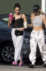 Delilah Belle Hamlin In track suit pants and fluffy slippers while picking up coffee in West Hollywood