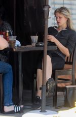 Eliza Scanlen Sits down for an al fresco lunch with a friend in Hollywood