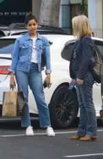 Freida Pinto Chats with a friend after lunch and shopping at Erewhon in Los Angeles