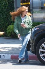 Isla Fisher Gets some retail therapy during an outing with a friend on Melrose Place in LA