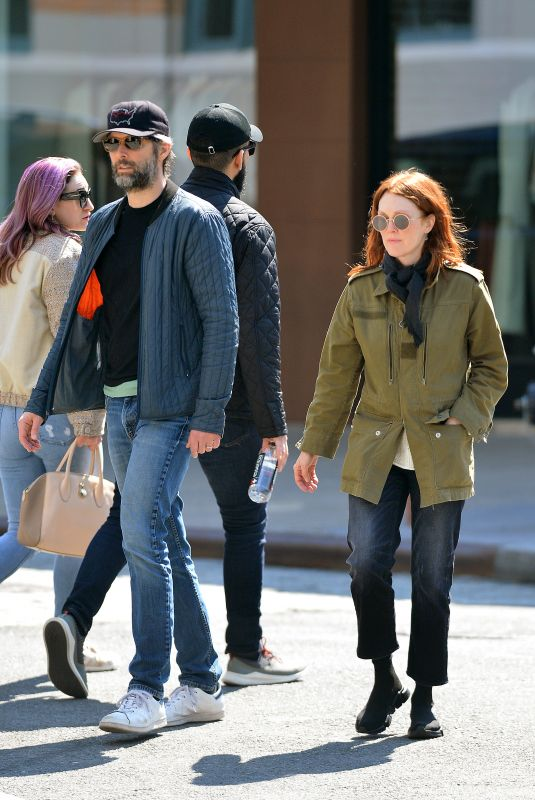 Julianne Moore and Bart Freundlich check out a new Tesla in NYC
