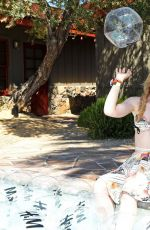 Kathryn Newton Poolside with H&M in Palm Springs