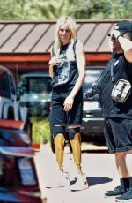 Lauren Wasser Shows off new gold prosthetics as she heads to coachella festival