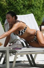 Lilly Becker In an animal print bikini as she relaxes by the pool in Miami
