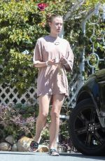Lucy Fry Checks out a Vintage 1970