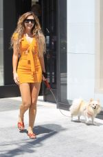 Megan Pormer Shares a smile with her dog as she goes shopping at Chanel in Beverly Hills