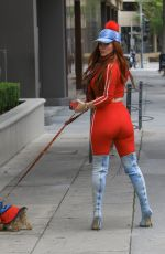 Phoebe Price Gets cheeky as she takes her dog for a walk in Beverly Hills
