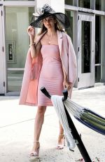 Rachel McCord Is pretty in pink arriving at Easter Sunday Service with husband Rick Schirmer in Bel Air