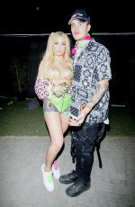 Tana Mongeau Bares it all as she poses with her Boyfriend at Coachella