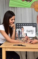 Victoria Justice Getting a temporary tattoo from Miryam Lumpini in Los Angeles