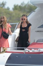 Alicia Vikander and friends in bikinis on a boat in Spain