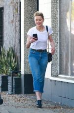 Amber Heard Stays glued to her phone while running errands with a friend in Los Angeles