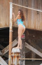 Blanca Blanco Poses in a blue one-piece swimsuit while playing at the beach in Malibu