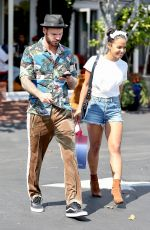 Christina Milian Aall smiles as she shops at Fred Segal with M. Pokora in West Hollywood