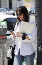 Dakota Johnson Holds on to her Mac Book after a lunch date with her friend in Beverly Hills