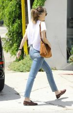 Dakota Johnson Leaves her car at the Valet ahead of her apointment in Los Angeles