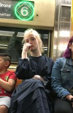 Elle Fanning Takes the subway in NYC
