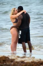 Iskra Lawrence In a bikini with boyfriend Philip Payne on the beach in Miami Beach
