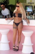 Katie Price aka Jordan finds herself at the bar and with a cool drink the order of the day in Majorca