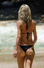 Lady Victoria Hervey In a racy bondage-style swimsuit while soaking up the sun in Barbados