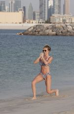 Laura Anderson Showing off her enviable figure whilst on holiday