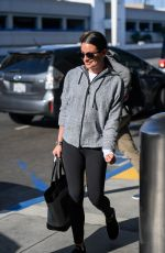 Lea Michele All smiles as she touches down in LA with her husband Zandy Reich