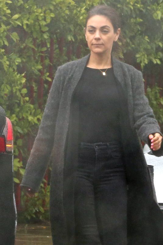 Mila Kunis Out in the rain in Los Angeles