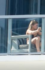 Paige VanZant Tanning on her hotel balcony in Miami