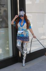 Phoebe Price Brings metallic boots to walk her dog in Beverly Hills