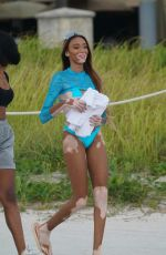 Winnie Harlow In a blue thong bikini at the beach in Miami