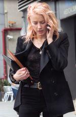 Amber Heard Stepped outside after a meeting in Los Angeles