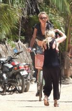 Anne Kee Molenarr and Mikky Kiemeney are among a group of models on the beach in Tulum doing a photoshoot