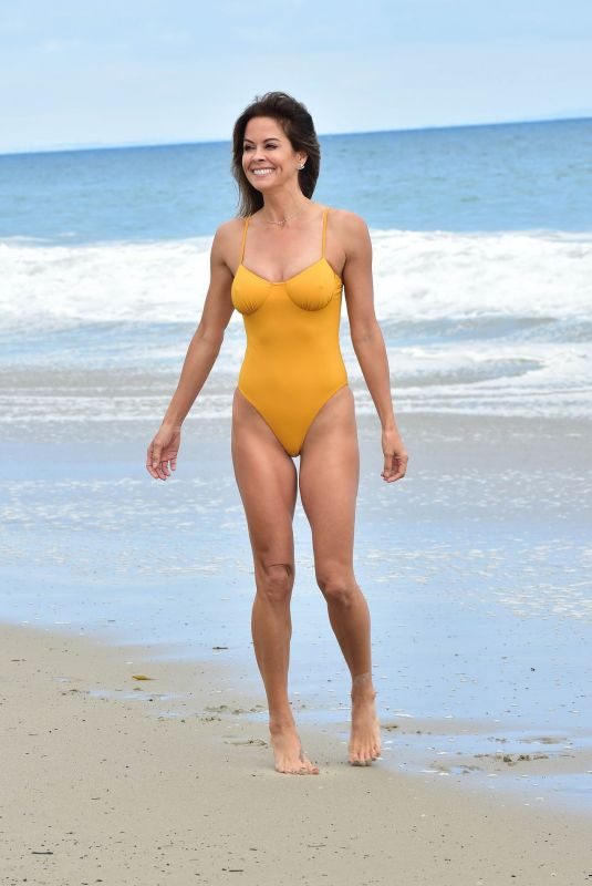 Brooke Burke-Charvet In a yellow swimsuit on the beach in Malibu